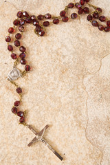 rosary on stone with copy space