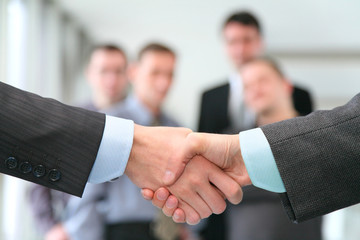 shaking hands with wrists