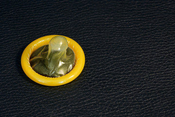yellow condom on leather