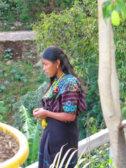 central america woman with a coloured dress, lake atitlan, guate
