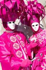 two venetians in pink costumes