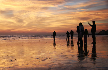 family sunset beach walk