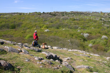 hikers and their dog on the top of hill, stenshuvu