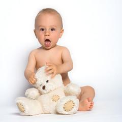cute infant with teddy bear