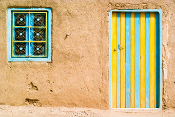 colored door in the desert, morocco