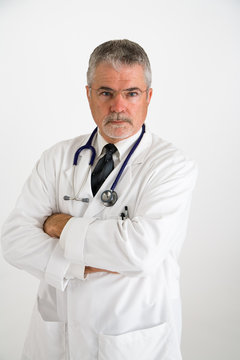 doctor with arms folded looking angry