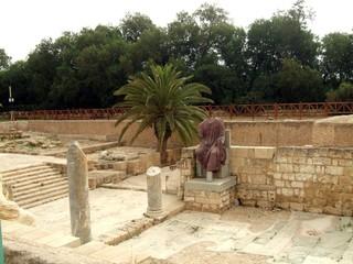 headless statue & roman columns & ruins