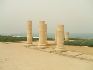 columns of roman capital city/caesarea on beach