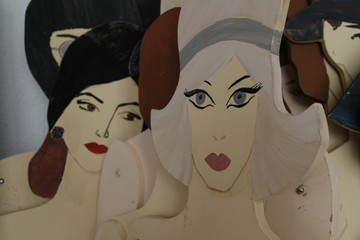 wooden cut out female figures