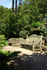 park bench in wooded setting