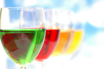 cocktails of various colors against the blue sky