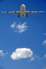 airliner and cloud