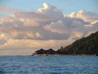 over water bungalows at sunset