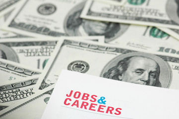 "employment concept - ""job and careers"" words over dollars"