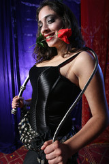 beautiful girl with a whip and red rose