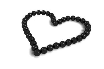 collier coeur perles noires sur fond blanc
