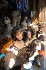 wigs in window