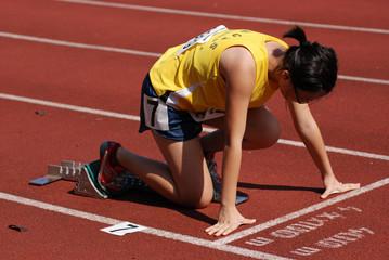 runner running on the track in the stadium