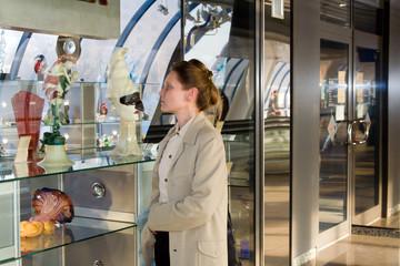 woman  examine show-window