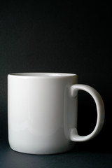 white mug isolated in black