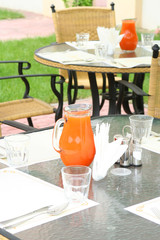 Restaurant table with jug of juice