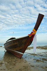Wall Mural - longtail boat in low tide, thailand