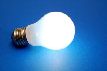 lit bulb on blue background