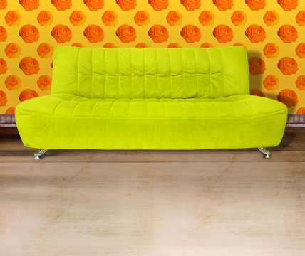 lime green couch against flower wallpaper