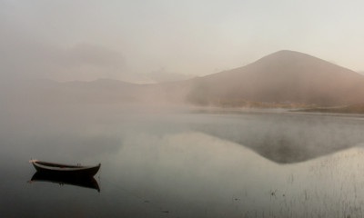boat, mountains and midnight's fog