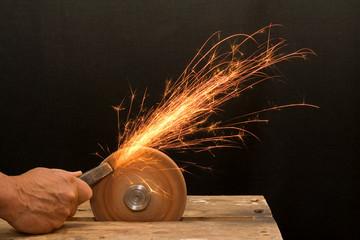 senior craftsman hand grinding