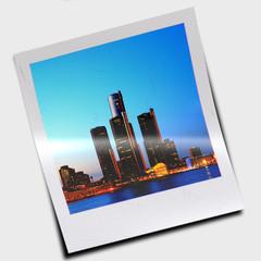 Polaroid slide with city at night