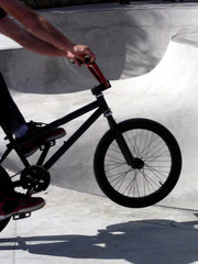 Cyclist heading for a bowl in a skate park