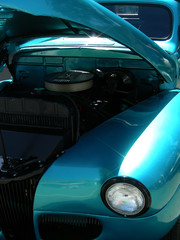 Blue 1941 antique roadster with open hood