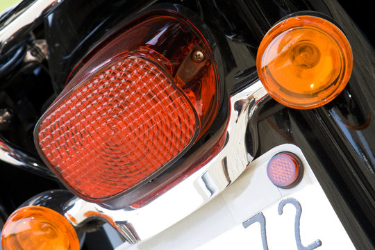 Close-up view of motorcycle rear lights