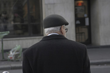 A senior citizen in Paris looking around and relaxing