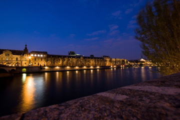 View across the Seine River at night, Paris, France