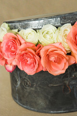 Arrangement of roses in a hat box