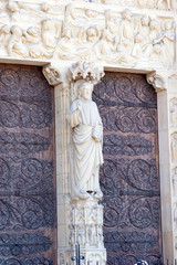 Statue at the Doors of Notre Dame