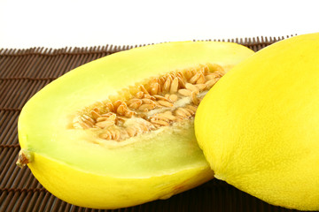 Canary melon isolated on white -yellow melon