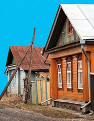 Russian rustic homes isolated on blue