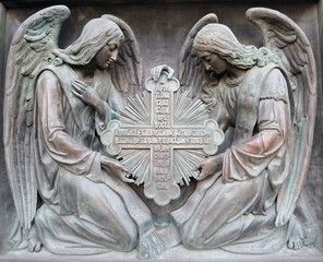 Bas-relief. Two angels hold cross.
