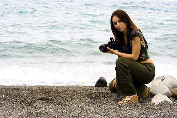 The girl the photographer on a sea beach
