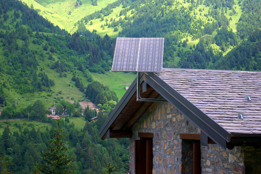 Photovoltaic panels on a log cabin