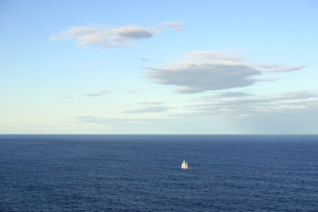 A single sailing ship on the pacific ocean
