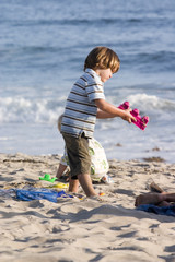 Child playing at the beach 7