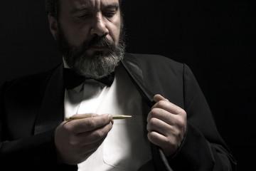 portrait of gentleman with pencil in hand