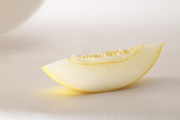 fresh ripe sliced melon over white background
