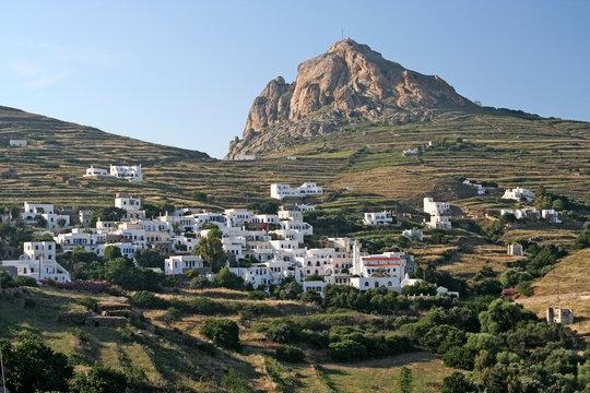 A typical Greek island village under a rock in Tinos island