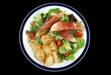 Chicken tenderloins wrapped in prosciutto with a garden salad.