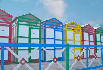 bathing huts St Pol with colourful  painted fence